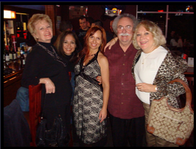Janine with Dad, Martha (left of Janine) & friends, early 2009