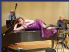 I've ALWAYS wanted to sing in an evening gown while laying on a grand piano!  (Sr. Recital, UNR, 2003)